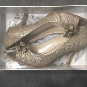 New in box Caparros gold shoes